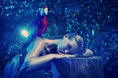 Senual lady with a colorful ara parrot Stock Photography