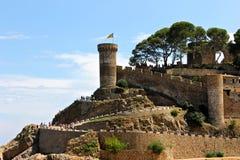 Senyera estelada, Tossa de Mar, Catalonia, Spain. A Senyera estelada, the unofficial flag typically flown by Catalan independence supporters, waving on the tower Stock Photos