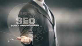 SEO †'wyszukiwarka optymalizacja z holograma biznesmena pojęciem zdjęcie wideo