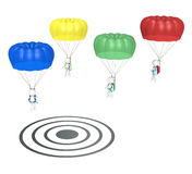 SEO. 3D little human characters X 4 with Parachutes and Tablet Pad Computers. Landing on Target. People series Royalty Free Stock Photo