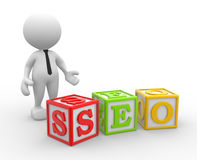 Seo. 3d people - man, person with a cubes and word seo. Search Engine Optimization Royalty Free Stock Photos
