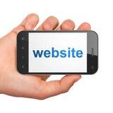 SEO网络设计概念:智能手机的网站 库存图片
