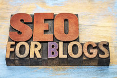 SEO for blogs in wood type Royalty Free Stock Images