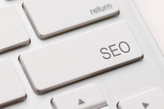 SEO button on the keyboard Royalty Free Stock Photo