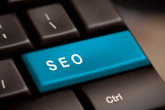SEO button on the keyboard royalty free stock photos