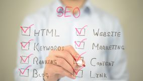 Seo, Check List,  Man writing on transparent screen Royalty Free Stock Photo