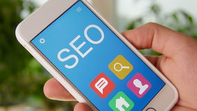 SEO concept application on the smartphone. Man uses mobile app. stock video