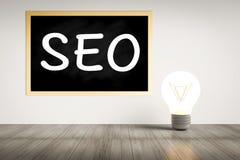 Seo concept. Seo on blackboard with idea lightbulb Stock Photos