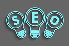 Seo concept with bulb and gears. A seo concept with bulb and gears Stock Photos