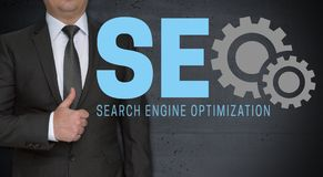 SEO concept and businessman with thumbs up.  royalty free stock images