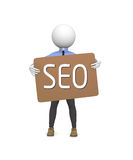 SEO concept. 3d business man holding a cardboard with SEO Stock Images