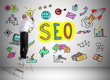 Seo concept drawn by a man on a ladder Royalty Free Stock Image