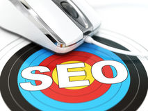SEO concept. Mouse on the target with text. Stock Images