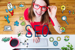 SEO concept with young woman Stock Images