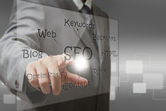 SEO diagram screen. Business man hand point on SEO diagram screen Stock Photos