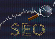 Seo and graph with a magnifying glass. Royalty Free Stock Photo