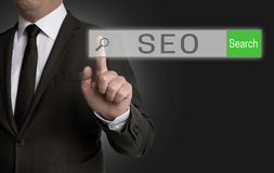 SEO internet browser is operated by businessman Royalty Free Stock Images
