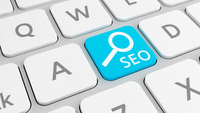 SEO on key in blue Stock Images