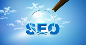 Seo and magnifying glass on Stock Photo