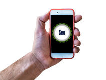 Seo Marketing Concept Hand holding mobile isolated on white. Close Stock Images