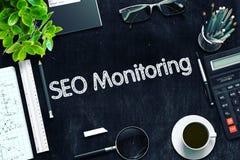 SEO Monitoring on Black Chalkboard. 3D Rendering. royalty free stock image