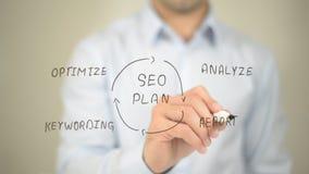 SEO Plan, Concept Illustration, Man writing on transparent screen stock photo