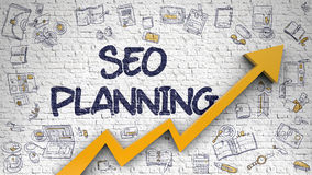 SEO Planning Drawn sur le mur de briques blanc Photo libre de droits