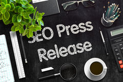 SEO Press Release - Text on Black Chalkboard. 3D Rendering. Royalty Free Stock Photos