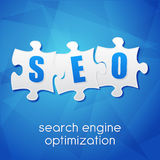 SEO in puzzle, search engine optimization, flat design Royalty Free Stock Photos