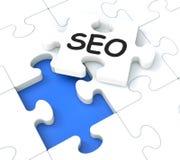 SEO Puzzle Showing E-marknadsföring och befordringar Fotografering för Bildbyråer