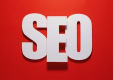Seo on red. Symbol made of paper with red background Royalty Free Stock Photos