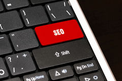 Seo on Red Enter Button on black keyboard Stock Photography