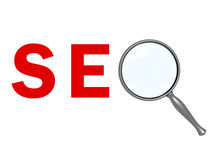 SEO Search Concept red text with magnifier Royalty Free Stock Photos