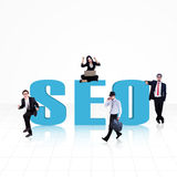 SEO - Search Engine Optimization. SEO (Search Engine Optimization) word surround with business people on white stock photos