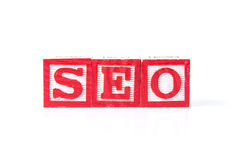SEO Search Engine Optimization - Alphabet Baby Blocks on white Stock Image