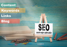 Seo search engine optimization, business and strategic concept. notice board by the books and money, and notifications.  Royalty Free Stock Image
