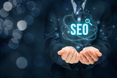 SEO search engine optimization. Search engine optimization - SEO concept. Businessman or programmer is focused to improve SEO and web traffic stock illustration