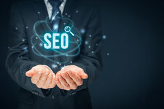 SEO search engine optimization. Search engine optimization - SEO concept. Businessman or programmer is focused to improve SEO and web traffic Royalty Free Stock Photo
