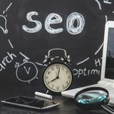 SEO Search engine optimization concept Magnifying glass, clock, smartphone on a black background with an inscription SEO Close up Stock Images