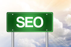 SEO, Search Engine Optimization, Green Road Sign Stock Photo