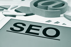 SEO, for Search Engine Optimization, in the screen of a tablet Royalty Free Stock Images