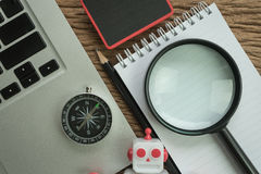 SEO search engine optimization website analysis concept with pen. Cil, compass, computer and magnifying glass in flat lay stock images