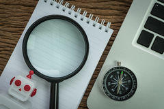 SEO search engine optimization website analysis concept with pen. Cil, compass, computer and magnifying glass in flat lay stock photo