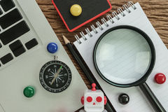 SEO search engine optimization website analysis concept with pen. Cil, compass, computer and magnifying glass on wood table royalty free stock photo
