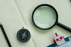 SEO search engine optimization website analysis concept with pen. Cil, compass, robot and magnifying glass royalty free stock photo