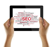 SEO. Or Search Engine Optimization For Website on tablet screen Stock Photography