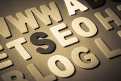SEO. (search engine optimization) word topic in cut wood letter royalty free stock image
