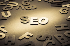 SEO. (search engine optimization) word topic in cut wood letter stock images