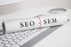 Seo sem written on newspaper Royalty Free Stock Photos