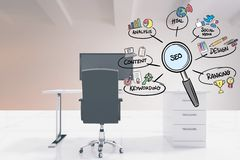 SEO sign in magnifying lens with various text and icons in office Royalty Free Stock Photos